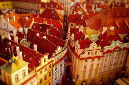 Red Prague roofs - view from the City Hall, travel european background with tilt-shift blurred effect Stock Photo
