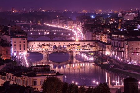 river arno: Night view of Florence city with Ponte Vecchio over river Arno and illumination. Travel sightseeing background.