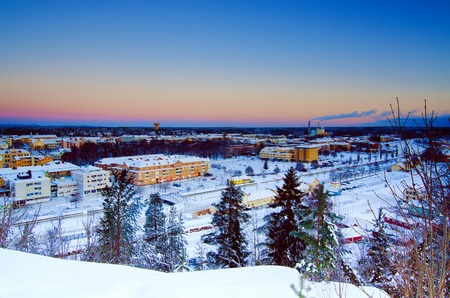 View of small swedish european town Soderhamn at sunrise, winter seasonal background