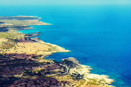 fontana: View from above to the Cyprus island sea coast with blue water and lagoons. Akamas cape landscape. Natural seasonal summer vacation background.