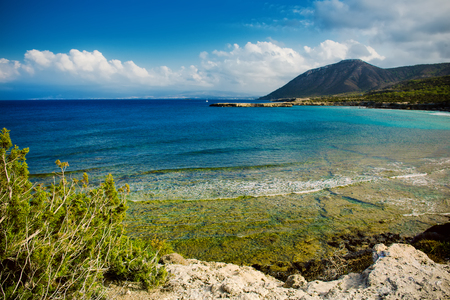 fontana: View to the Cyprus island sea coast with blue water and mountain. Akamas cape landscape. Natural seasonal summer vacation background.