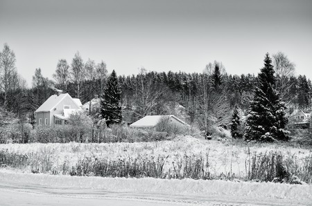 urban idyll: View of small swedish european town Soderhamn, winter seasonal background in black and white copors