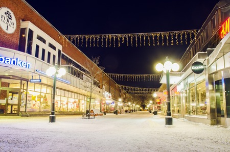 urban idyll: SODERHAMN, SWEDEN - 25.12.2014: View of the center of small european swedish city with holiday illumination at Christmas night Editorial
