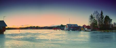 sweden in winter: Fisherman village in Sweden at winter after sunset - winter seasonal scandinavian background