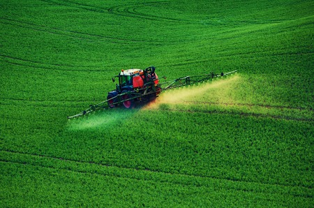 Farm machinery spraying insecticide
