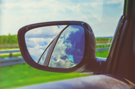Landscape in the sideview mirror of a car