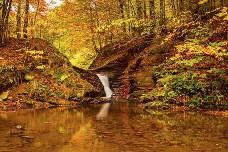Autumn mountain waterfall