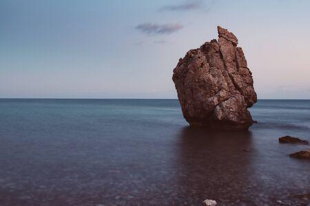 Love beach. Aphrodite's Rock - Aphrodite's birthplace near Paphos City. Cyprus island at sunset