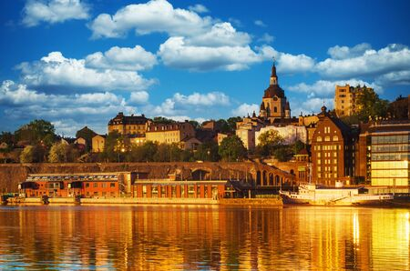 View of the famous scandinavian and north european city Stockholm - the capital of Sweden at sunrise with water reflection