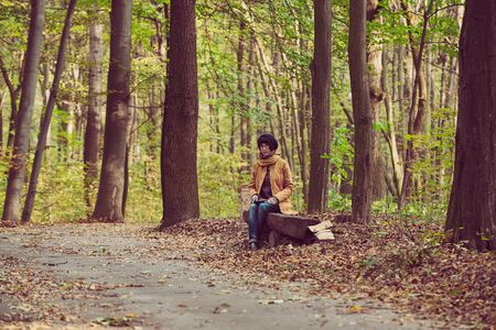 Hipster girl in a park 版權商用圖片