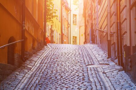 The narrow street of Gamla Stan - historic city old center of Stockholm at summer