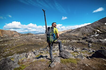 Man with telemark ski ready for skiing in Iceland Landmannalaugar mountains, sports outdoor concept