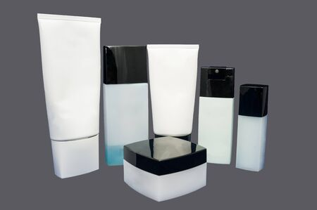 set of hand cream box isolated on grey photo