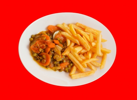 Vegetables with french fried isolated on red back photo