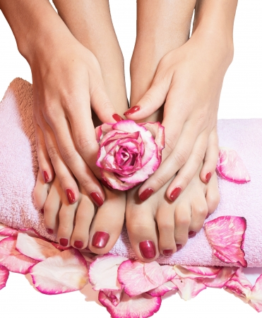 beautiful legs, hands, flowers and petals on towel photo
