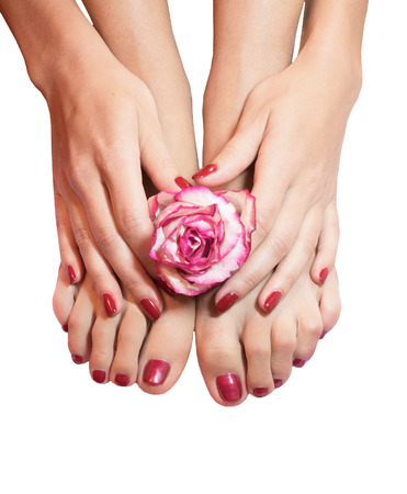 beautiful legs, hands, flowers and petals on towel, isolated photo