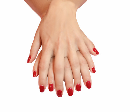 laque: Young woman hands with red manicure over isolated white background
