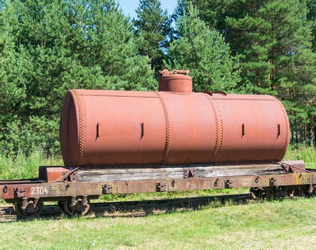 old tanks with oil and fuel transport by rail photo
