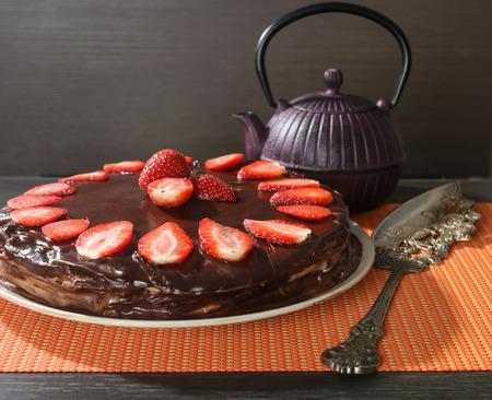 Homemade sweet chocolate cake with strawberries Stock Photo