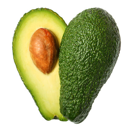 Fresh avocado in the shape of a heart isolated on white background photo