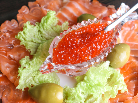 crystal bowl: red caviar in a crystal bowl with salmon olives and green salad