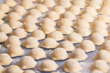 Homemade raw pastry dumplings with meat filling called pelmeni photo