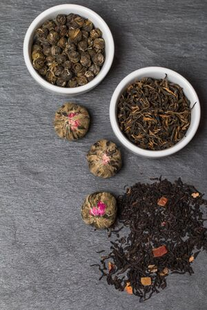 sampler: different sorts of tea leaves close up