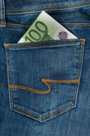 one hundred euro banknote: One hundred euro banknote in the jeans pocket Stock Photo