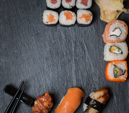 SUSHI: sushi and rolls on black background top view Stock Photo