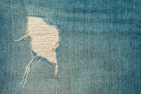 tatter: ragged jeans background and texture