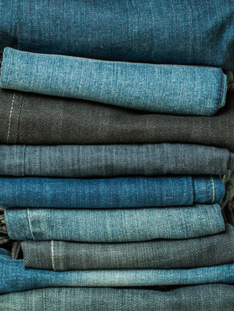 Lot of different blue jeans close-up photo