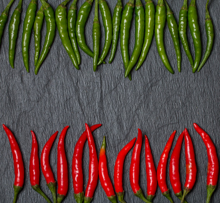 frame of red and green Chile pepper on black background photo