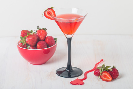 Strawberry lemonade with ice in glass on white wooden background Stok Fotoğraf