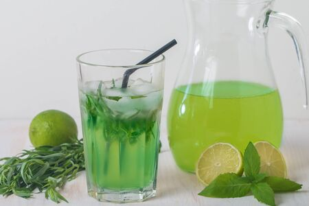 tarragon: homemade lemonade from lime and tarragon on white wooden backgraund