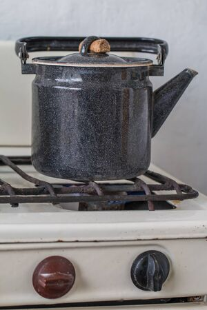 old gas stove: Old kettle on a gas stove flame burn not boiling