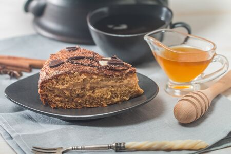 wooden stick: Homemade honey cakes with bowl of honey on wooden table