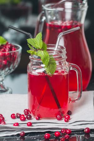cranberry juice: Fresh cranberry juice with mint on black background Stock Photo