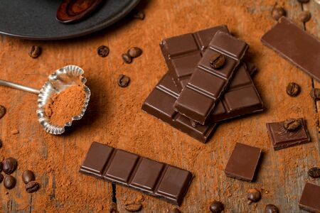 cocoa powder: Cocoa Powder and Dark Chocolate on old wooden table Stock Photo