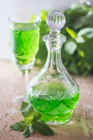 absinthe: Green drink with soda, tarragon and mint, selective focus Foto de archivo