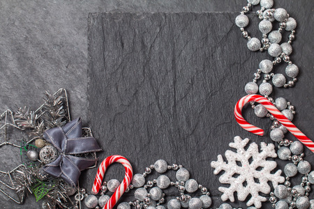 black stone: Christmas still life with copy space on black background
