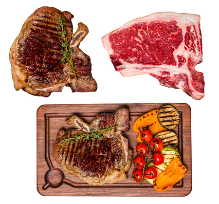 green board: Set of isolated Club Beef steak with Grilled vegetables, top view
