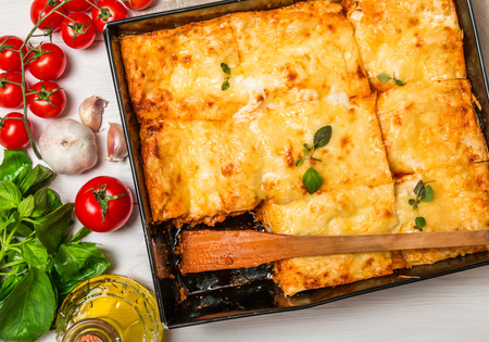 Delicious traditional italian lasagna  with ingredients served on white  wooden table, top view Stock fotó