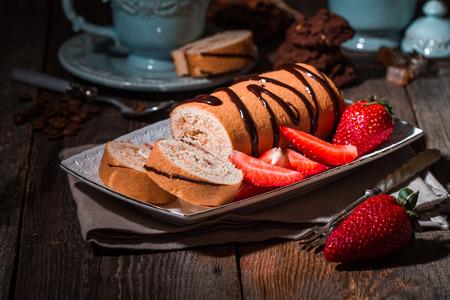 custard slices: Fresh strawberries cake on plate with coffee on dark wooden background