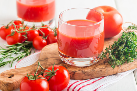 tomato juice: Tomato Juice and Fresh Tomatoes  on a White Wooden Background
