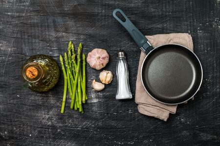 Ingredients for cooking asparagus on a black background, top view Reklamní fotografie