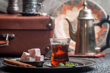 delight: Turkish tea in traditional glass cup with turkish delight Stock Photo