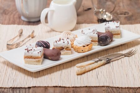 chocolaty: Small cakes with different stuffing on white plate