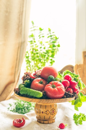 lite: Still life of fresh vegatables in a wooden plate on lite background