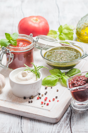 Various dip sauces on white wooden table Stock Photo - 59650058
