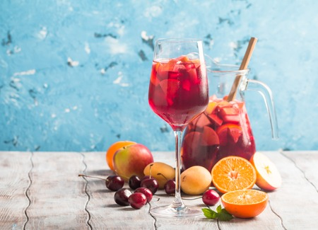 pincher: Refreshing sangria or punch with fruits in glass and pincher Stock Photo